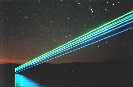 (Click To Zoom) nighttime photo of an argon laser beam (coherent cr52, 5-watt) scanning out over a lake (courtesy of laserist John Wieczorek)